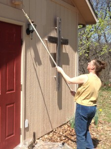 Mary is adding a much needed coat of paint to the camp chapel.