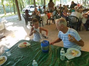 Visitors got a chance to eat and visit with the campers.